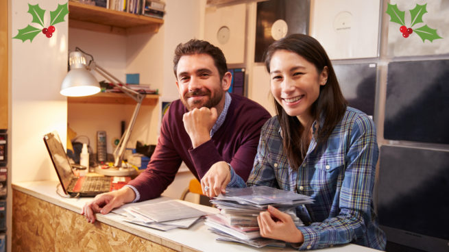 couple business owners at desk smiling