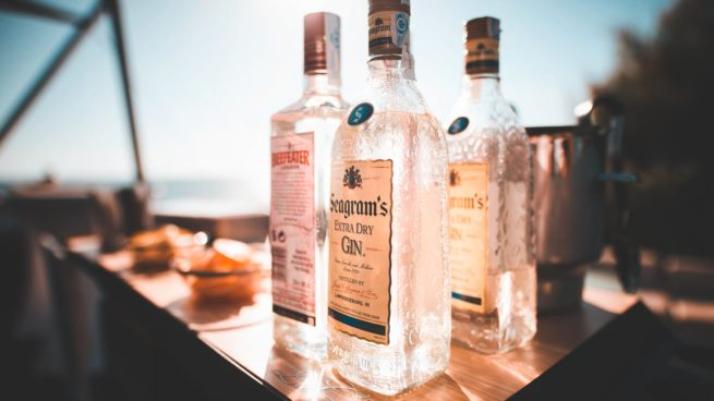 gin bottles with sky background
