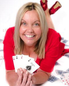 female magician holding cards