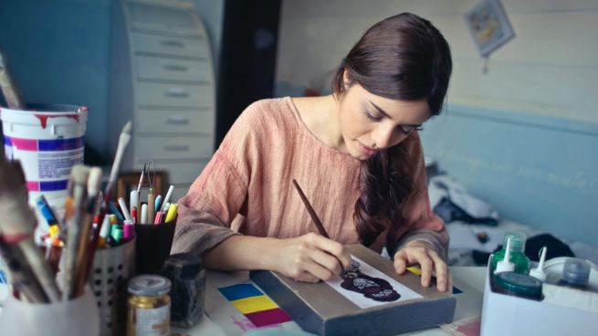 woman painting at desk